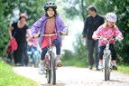 Photo of children cycling on a greenway