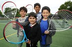 Photo of children playing tennis at Cantley Park