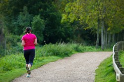 Photo of a woman running in Dinton Pastures