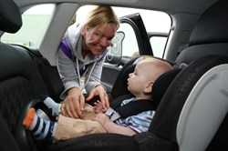 Photo of a child in an in-car safety seat