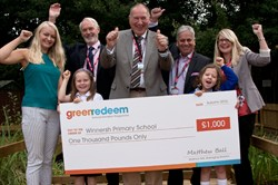 Photo of a Greenredeem cheque presentation at Winnersh Primary School