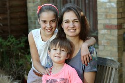 Photo of a foster carer and her family